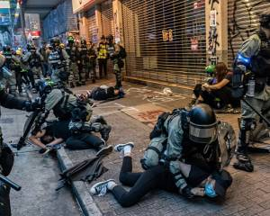 Hong Kong: Crackdown on democratic freedoms continues with mass arrests